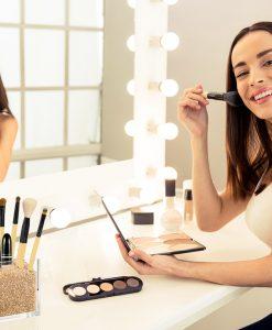 Model with Gold Makeup Brush Holder